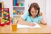 Teen girl practicing and doing homework — Stock Photo