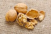 Walnuts on homespun linen background — Stock Photo