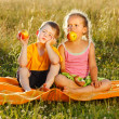Little girl and boy eating apple — Stock Photo #6161700