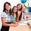 Stock Photo: Cheerful teacher and several students