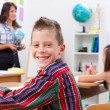 Cheerful young boy in school — Stock Photo #6161714