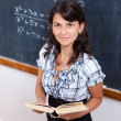 Proud math teacher with book — Stock Photo #6161722