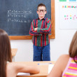 Eminent boy in front of class — Stock Photo