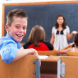 Cheerful boy in class room — Stok fotoğraf