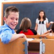 Stock Photo: Cheerful boy in class room