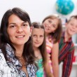 Cheerful teacher and several students — Stockfoto