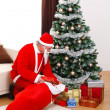 Santa Claus bringing presents in Christmas — Stock Photo