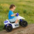 Little boy driving off road toy quad — Stock Photo #6161821