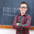 Eminent boy at chalkboard — Stock Photo