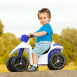 Little boy sitting on toy quad — Stock Photo #6161840