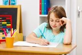 Schoolgirl writing homework — Foto Stock