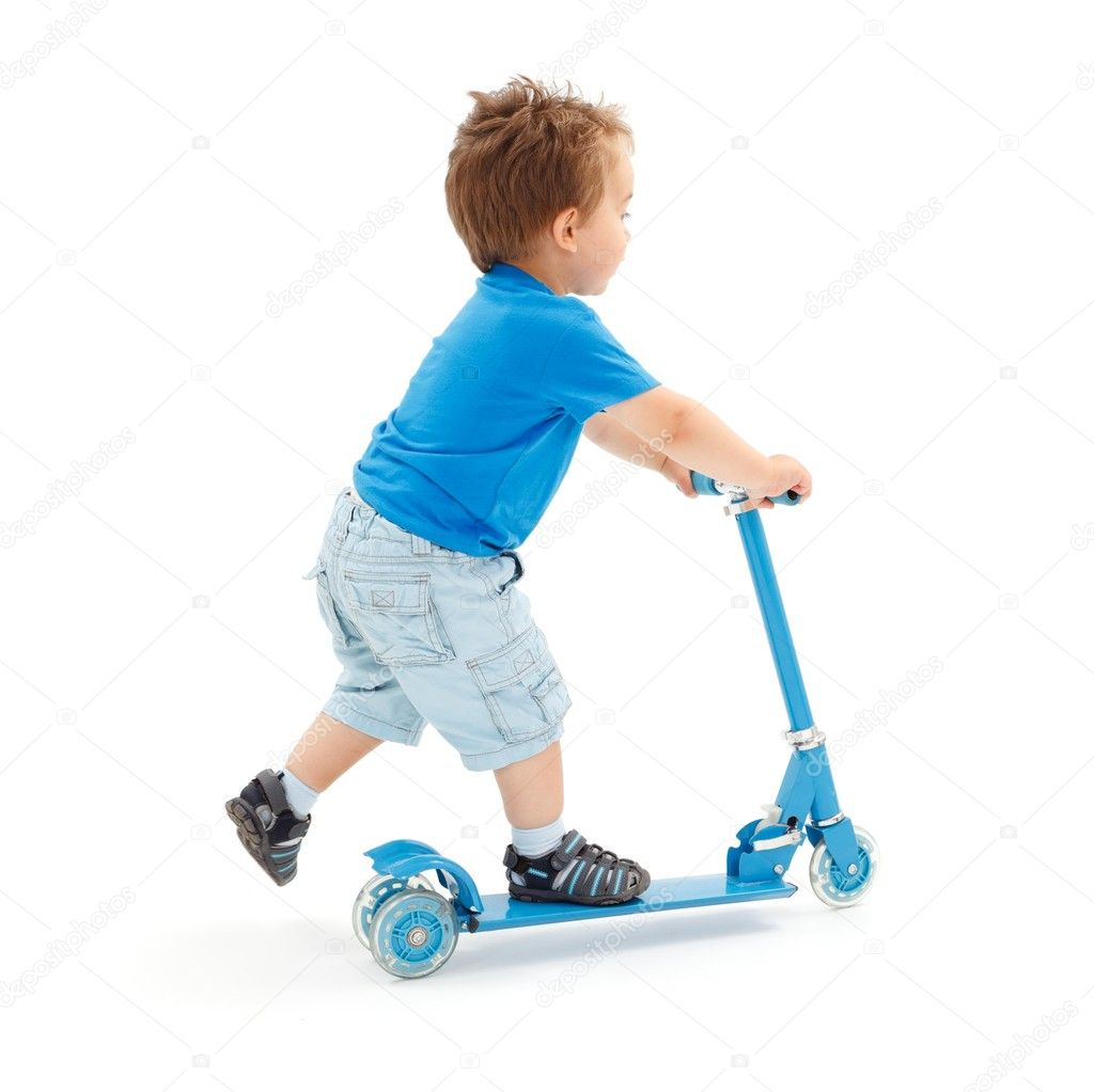 Little boy going fast with toy scooter (partial motion blur on leg) — Stock Photo #6161798
