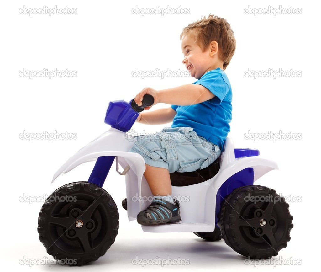 Little boy going fast with a little toy quad — Stock Photo #6161877
