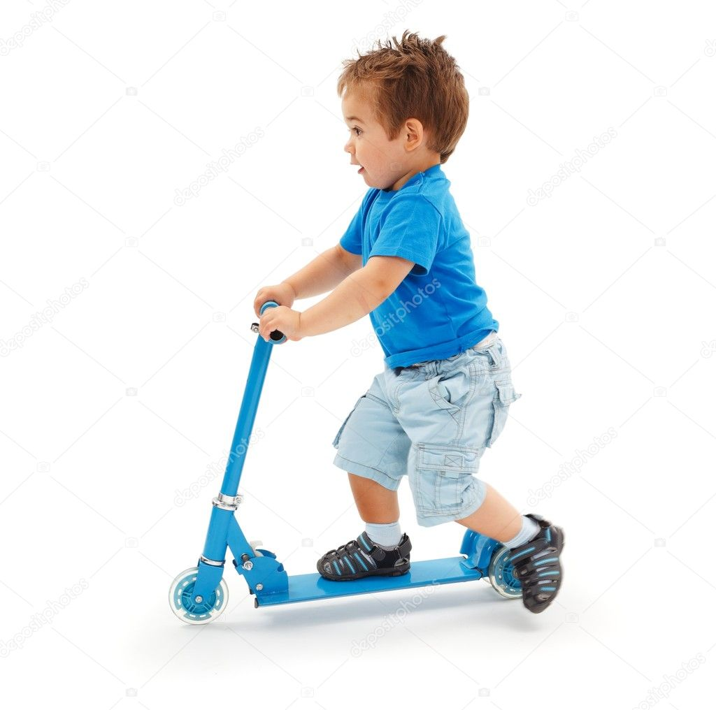 Boy Toys Blue : Boy playing with blue toy scooter — stock photo erierika