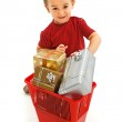 Little boy throwing presents in garbage bin — Stock Photo #6427398