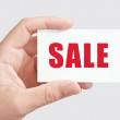 """Hand holding card """"SALE"""" — Stock Photo #6541429"""