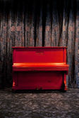 Vintage red piano — Stock Photo