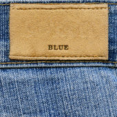 """Label with word """"BLUE"""" on denim — Photo"""
