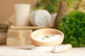 Spa setting with bath salt and towel — Stock Photo