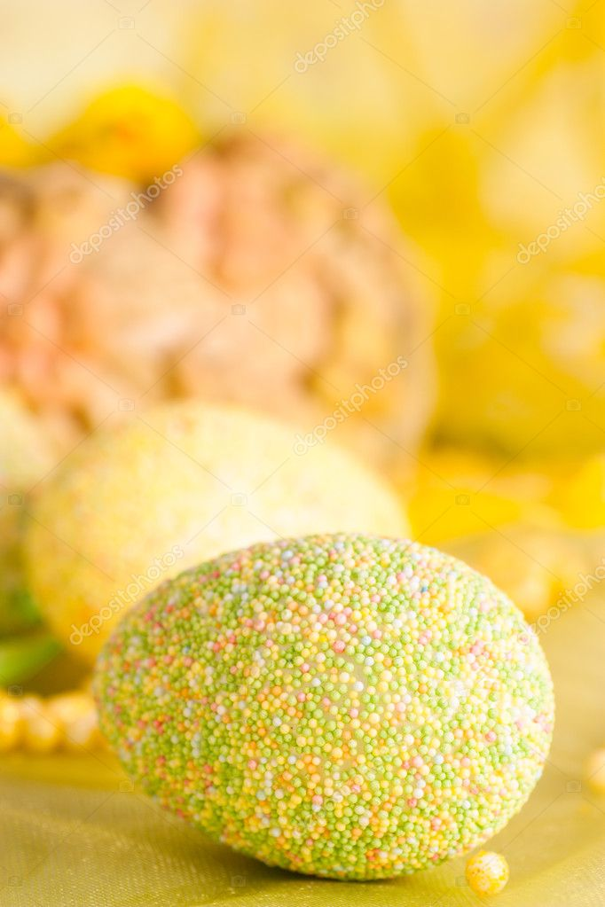 Easter setting with Easter eggs in green and yellow — Stock Photo #5818679