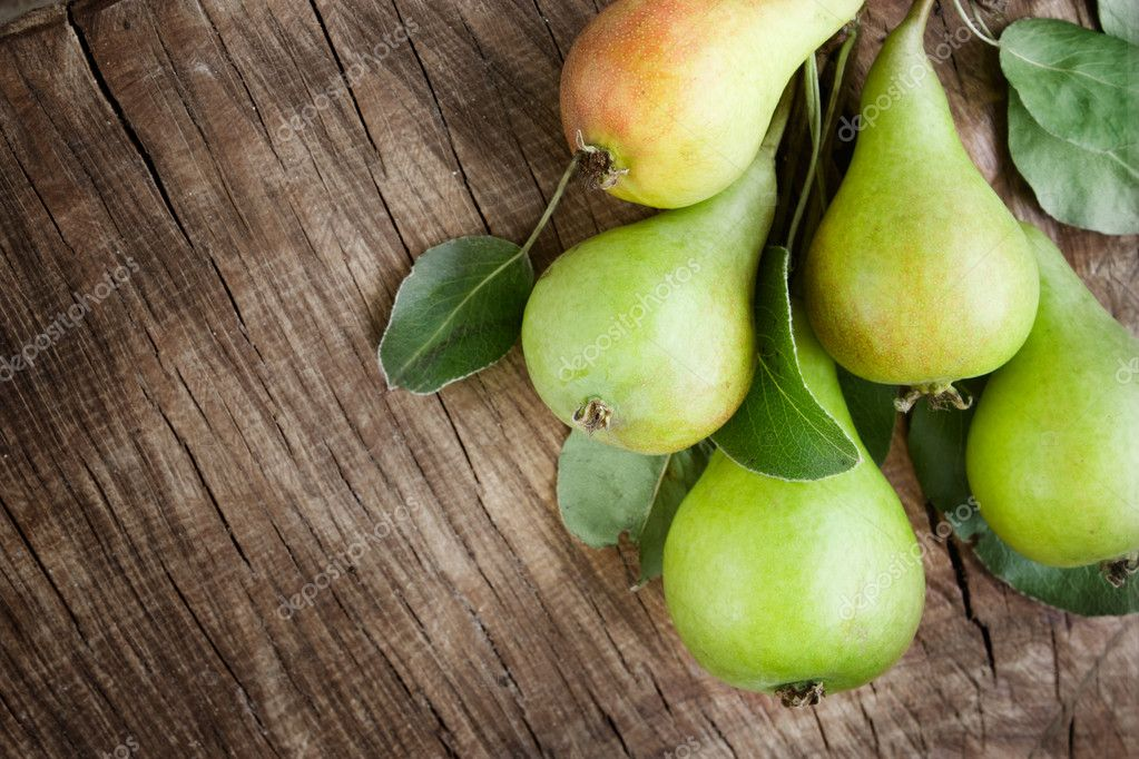 Freshly harvested pears on old wooden background  Stock Photo #6006403