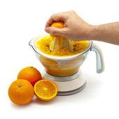 Squeezing Orange Juice — Stock Photo