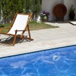Deckchair in swimming pool — Stock Photo #6259166