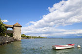 Rowboat in the Rolle Castle jetty in Switzerland — Stock Photo