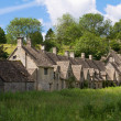 Arlington Row in Bibury with River Coln, Cotswolds, Gloucestershire, UK - Stock Photo