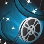 Film Reel on Blue Background — Stock Vector #6029979
