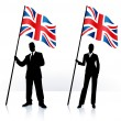 Business silhouettes with waving flag of United Kingdom — Stock Vector