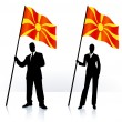 Business silhouettes with waving flag of Macedonia — Stock Vector