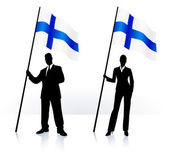 Business silhouettes with waving flag of Finland — Stock Vector