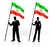Business silhouettes with waving flag of Iran — Stock Vector