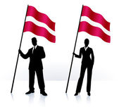 Business silhouettes with waving flag of Latvia — Stock Vector