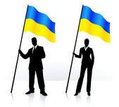 Business silhouettes with waving flag of Ukraine — Stock Vector