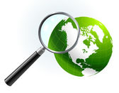 Green Globe under magnifying glass — Stock Vector