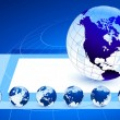 Globes on blue internet background — Cтоковый вектор #6087313