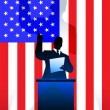 Постер, плакат: USA flag with political speaker behind a podium