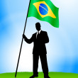 Royalty-Free Stock Vector Image: Businessman Leader Holding Brazil Flag