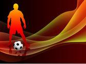 Giocatore di calcio su sfondo arancione astratto — Vettoriale Stock