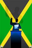 Drapeau de la jamaïque avec une enceinte politique derrière un podium — Vecteur