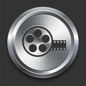 Icono del cine carrete en metal botón internet — Vector de stock