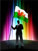 Wales Flag with Businessman on Abstract Spectrum Background — Stock Vector