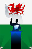 Wales flag with political speaker behind a podium — Stock Vector