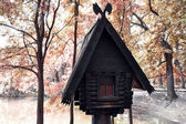 A log hut on the bank of lake — ストック写真