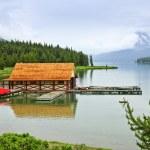 Boathouse on mountain lake — Stock Photo