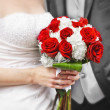 Bride and groom with bridal bouquet - Stockfoto