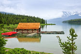 Boathouse on mountain lake — Stock Photo