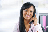 Young black businesswoman talking on phone — Stock Photo